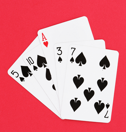 individuality: Individuality concept. Playing cards on red background