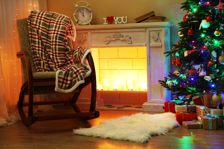 place of living: Beautiful Christmas interior with fireplace and fir tree