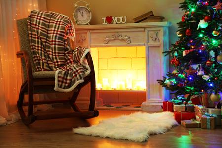 christmas room: Beautiful Christmas interior with fireplace and fir tree