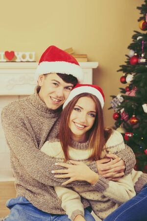 love tree: Nice love couple near Christmas tree. Woman and man celebrating Christmas