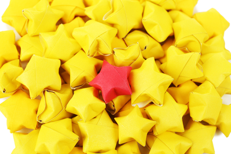 red star: Individuality concept. Origami stars group, close-up