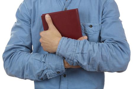 man holding book: Man holding book closeup