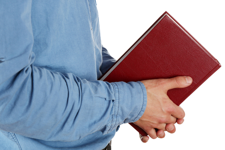 man holding book: Man holding book isolated on white