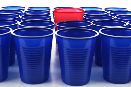 Individuality concept. Bright plastic disposable tableware, close-up Stock Photo