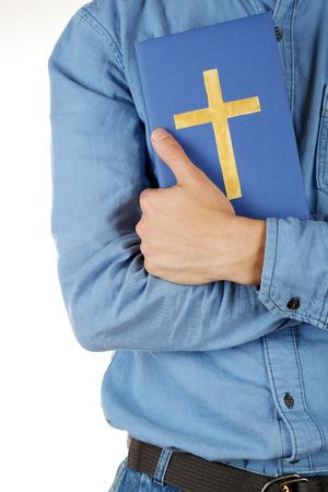 holding bible: Man holding Bible close up