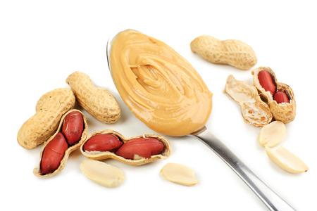 creamy: Creamy peanut butter in spoon, close-up
