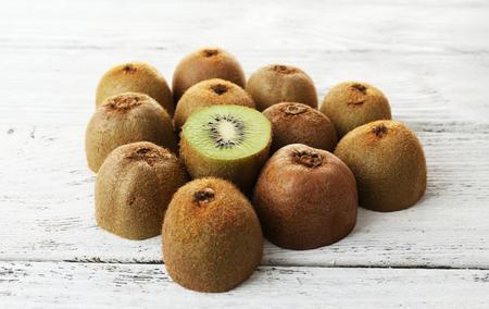 juicy: Juicy kiwi on wooden table Stock Photo
