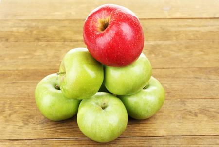 juicy: Juicy apples on wooden table Stock Photo