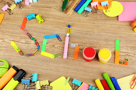 crayon  scissors: Inscription school lined of school supplies on wooden background