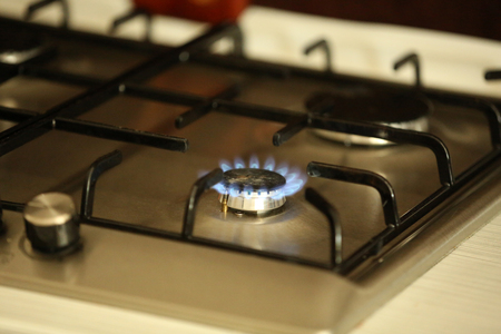 gas burner: Gas burner with flame on gas cooker Stock Photo