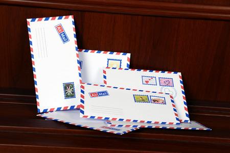 enveloped: Letters on floor at front door indoor Stock Photo