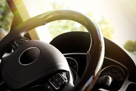 car navigation: Modern car interior. Steering wheel, close-up