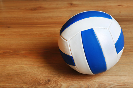 volleyball team: Volleyball ball on wooden background Stock Photo