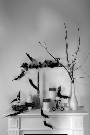 witchery: Halloween composition on fireplace in room
