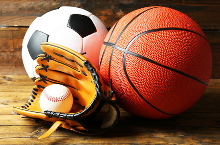 Sports balls on wooden background Foto de archivo