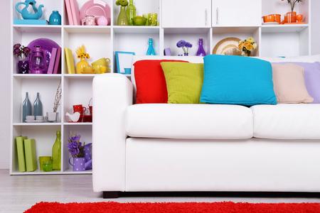 white sofa: Modern interior design. White living room with sofa and bookcase