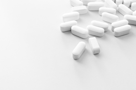 nutritional therapy: Pile of pills, close-up Stock Photo