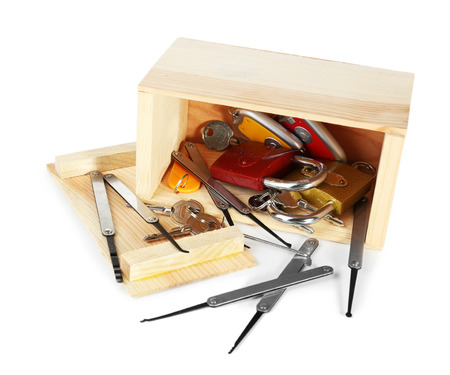 picks: Set of keys and lock picks in wooden box isolated on white