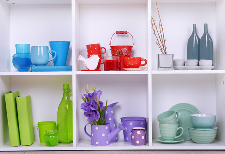living thing: White shelves with colorful things, close-up