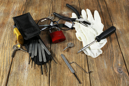 locksmith: Tools of picking locks on wooden table