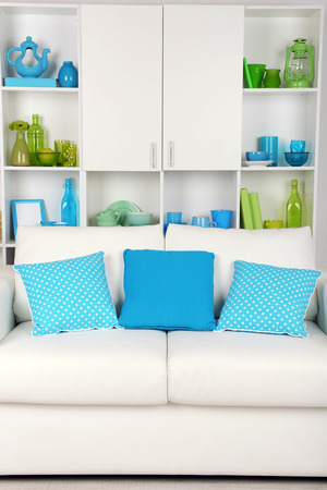 contemporary living room: Modern interior design. White living room with sofa and bookcase