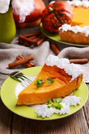 pumpkin pie: Piece of homemade pumpkin pie on plate on wooden background Stock Photo
