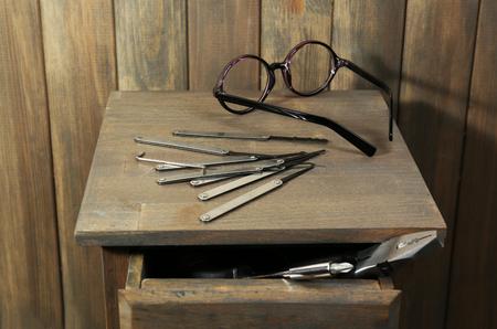 picks: Lock picks on wooden table Stock Photo