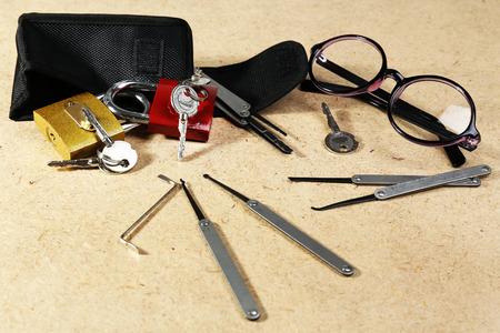 picks: Set of locks, keys and lock picks on wooden background