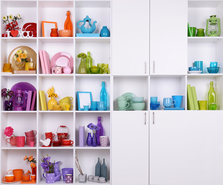 living thing: White shelves with colorful things in room Stock Photo