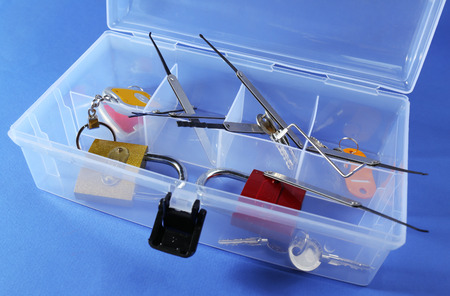 picks: Set of keys, lock picks in box on blue background