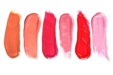 Verschillende lipgloss op wit wordt geïsoleerd