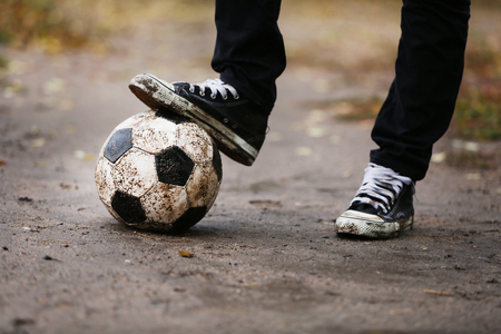 beat the competition: Soccer ball on ground in rainy day, outdoors