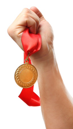 commendation: Golden medal in hand isolated on white