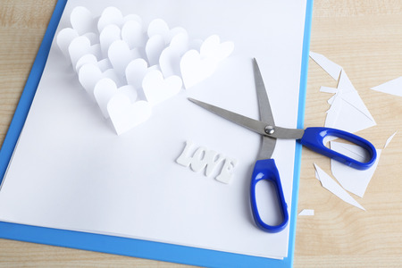 applique: Beautiful applique paper with hearts  and scissors on table Stock Photo