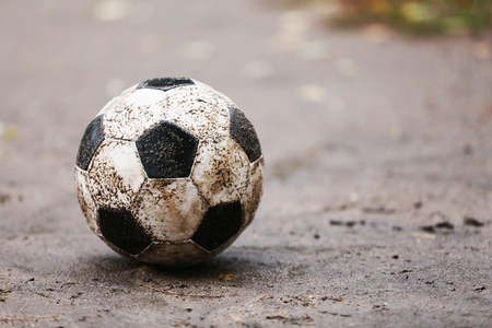 rainy day: Soccer ball on ground in rainy day, outdoors