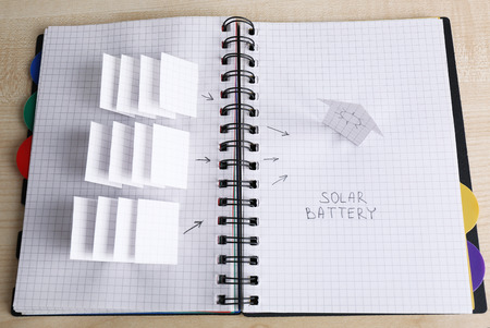 applique: Applique paper with building and solar panels in notebook