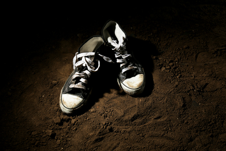 beat the competition: Sneakers on ground on dark background