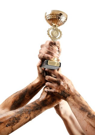 commendation: Gold cup in hands isolated on white