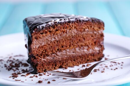 cake plate: Delicious chocolate cake on plate on table close-up Stock Photo