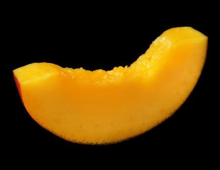 mango slice: Mango slice on black background