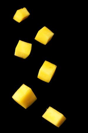 Mango slices on black background