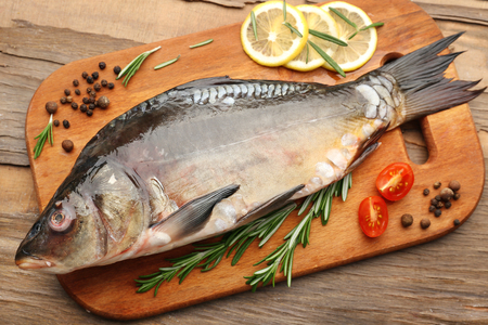 spicy food: Fresh raw fish and food ingredients on table