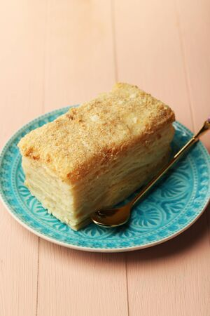 cake plate: Napoleon cake on plate on table close-up Stock Photo