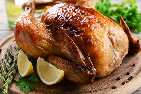 baked chicken: Delicious baked chicken on table close-up Stock Photo