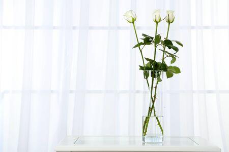luz natural: Beautiful bouquet of flowers in vase on window background Foto de archivo
