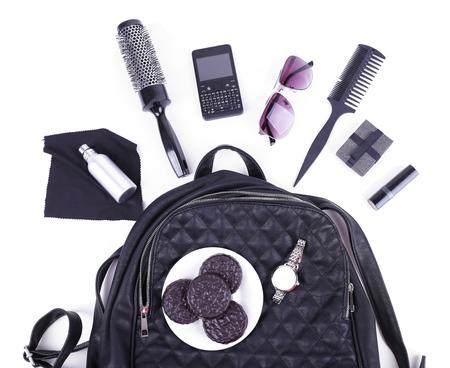 Content female handbag isolated on white Stock Photo