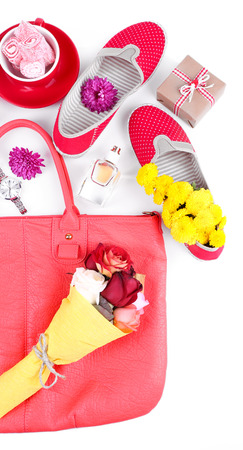 Women bag stuff top view isolated on white