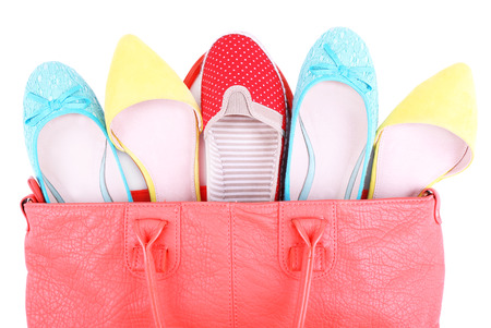 Women bag with shoes top view isolated on white