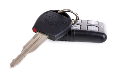 tool unlock: Car key with remote control isolated on white