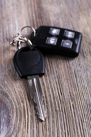tool unlock: Car key with remote control on wooden table, close-up Stock Photo